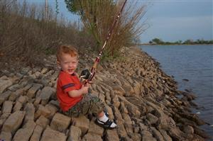 Little boy fishing.